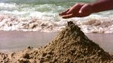 Hand Playing With Sand On Beach stock footage