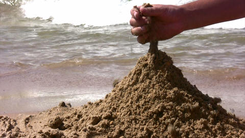 hand playing with sand on beach Stock Video Footage