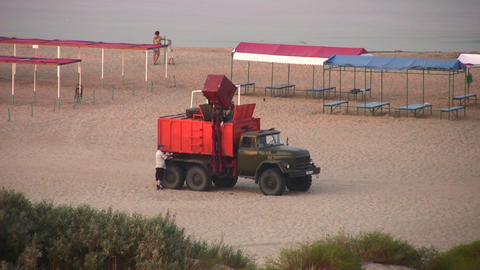 garbage car on beach Stock Video Footage
