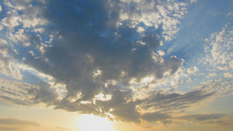 clouds with sun rays time lapse Footage