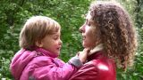 Faces Mother With Girl In Autumn Park stock footage