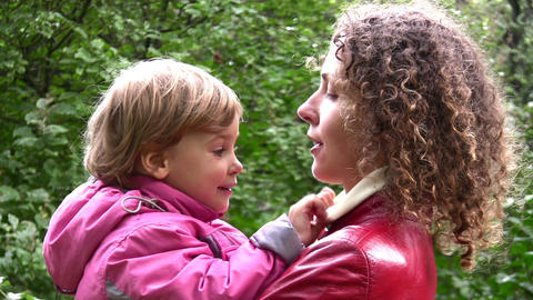 faces mother with girl in autumn park Stock Video Footage