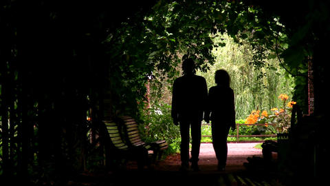 couple silhouette in plant tunnel Footage