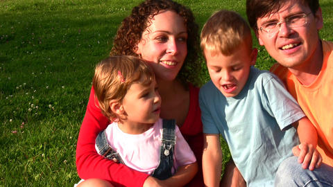 family of four faces singing Stock Video Footage