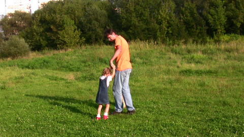 father rotating two children Stock Video Footage