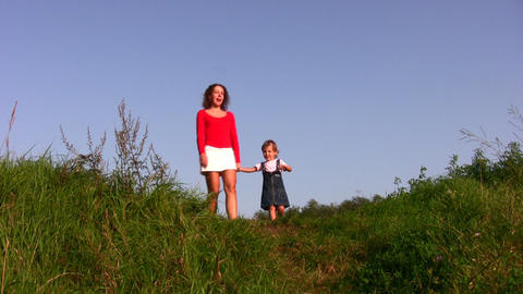 mother with girl on meadow Stock Video Footage