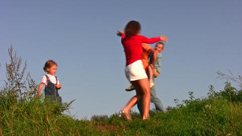Family Of Four Play On Meadow stock footage