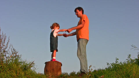 father whirl girl on stump Stock Video Footage