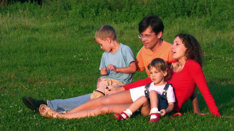 family of four on grass Footage