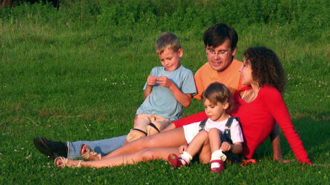 family of four on grass Stock Video Footage