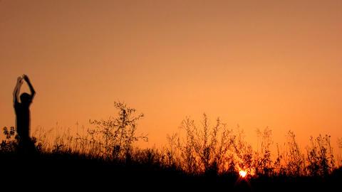 happy man silhouette on sunset sky Footage