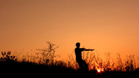 happy man silhouette on sunset sky Stock Video Footage