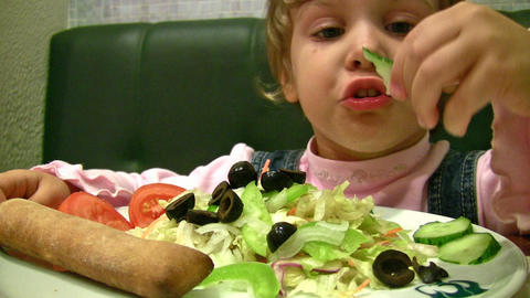 little girl eat salad Stock Video Footage