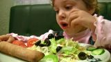 Little Girl Eat Salad stock footage