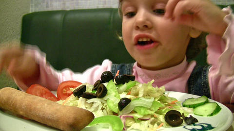little girl eat salad Footage