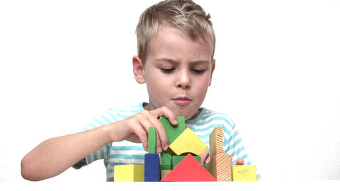 child with wood toy cubes Footage