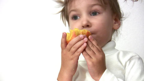 little girl with peach Stock Video Footage