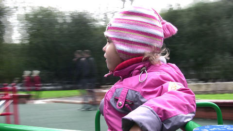 little girl on carousel Stock Video Footage