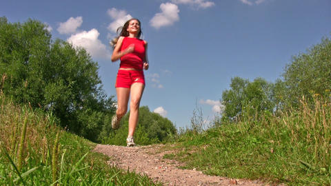 sport woman in red running in park Stock Video Footage