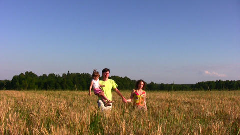 family with little girl in field Stock Video Footage