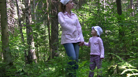 mother with girl in wood Footage