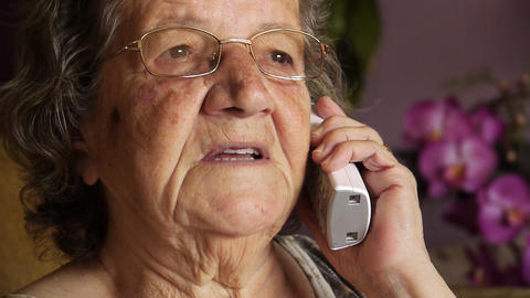 Old retired woman talking on phone Footage
