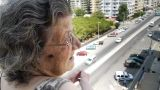 Old Retired Woman Watching Traffic stock footage