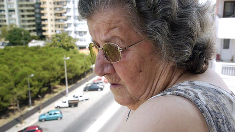 Old retired woman watching traffic Footage