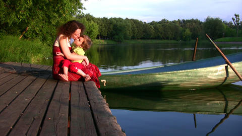 Mother with girl on pond and boat Footage