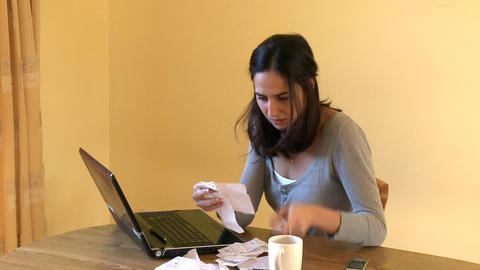 Stressed woman doing her accounts Stock Video Footage