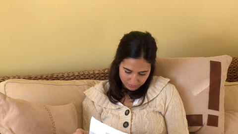 Concentrated woman reading a magazine sitting on s Footage