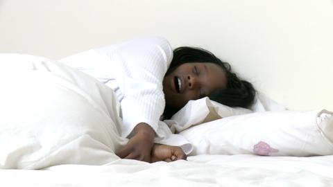 Ethnic woman waking up slowly Footage