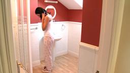 Brunette woman weighing herself Footage
