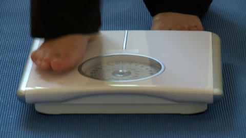 Close up of feet on scales Stock Video Footage
