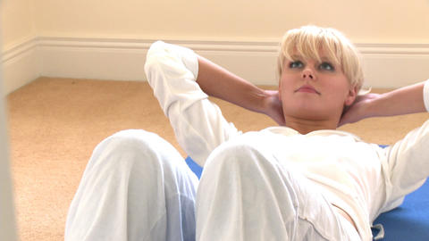 Blond woman doing situps Footage