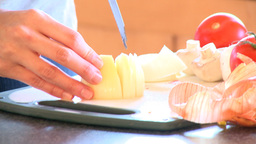 Close up of a woman cutting onions Stock Video Footage