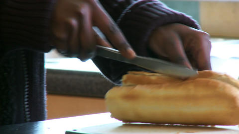 Close up of ethnic woman cutting bread Live Action