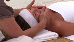 Peaceful woman enjoying a face massage Footage