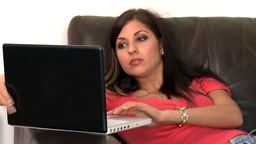 Attractive woman and her dog using a laptop Stock Video Footage