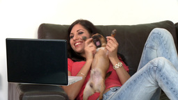 Blissful woman using a laptop sitting on sofa Footage