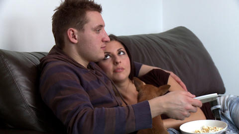 Romantic couple watching television sitting on sof Stock Video Footage