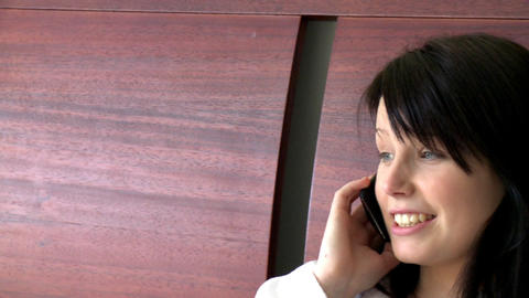 Cheerful woman talking on phone Stock Video Footage