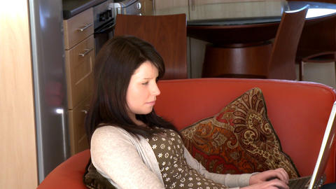 Peaceful woman using a laptop Stock Video Footage