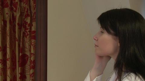 Pretty woman putting skin cream Stock Video Footage