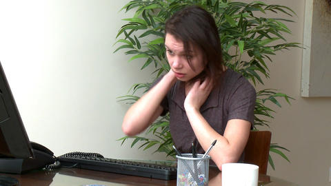 Overwhelmed woman working at a computer Footage