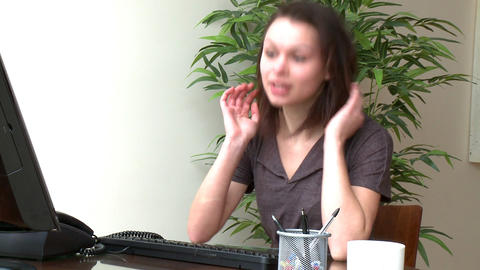 Tired woman working at a computer Stock Video Footage