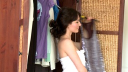 Charming young woman choosing clothes Stock Video Footage
