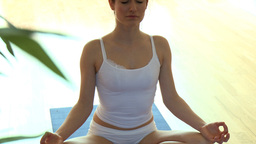 Relaxed brunette woman doing yoga Footage