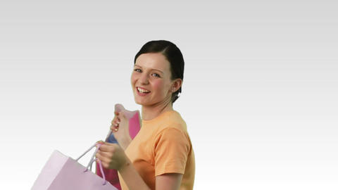 Smiling woman with shopping bags Stock Video Footage