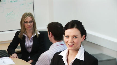 Woman showing leadership in a business team Live Action